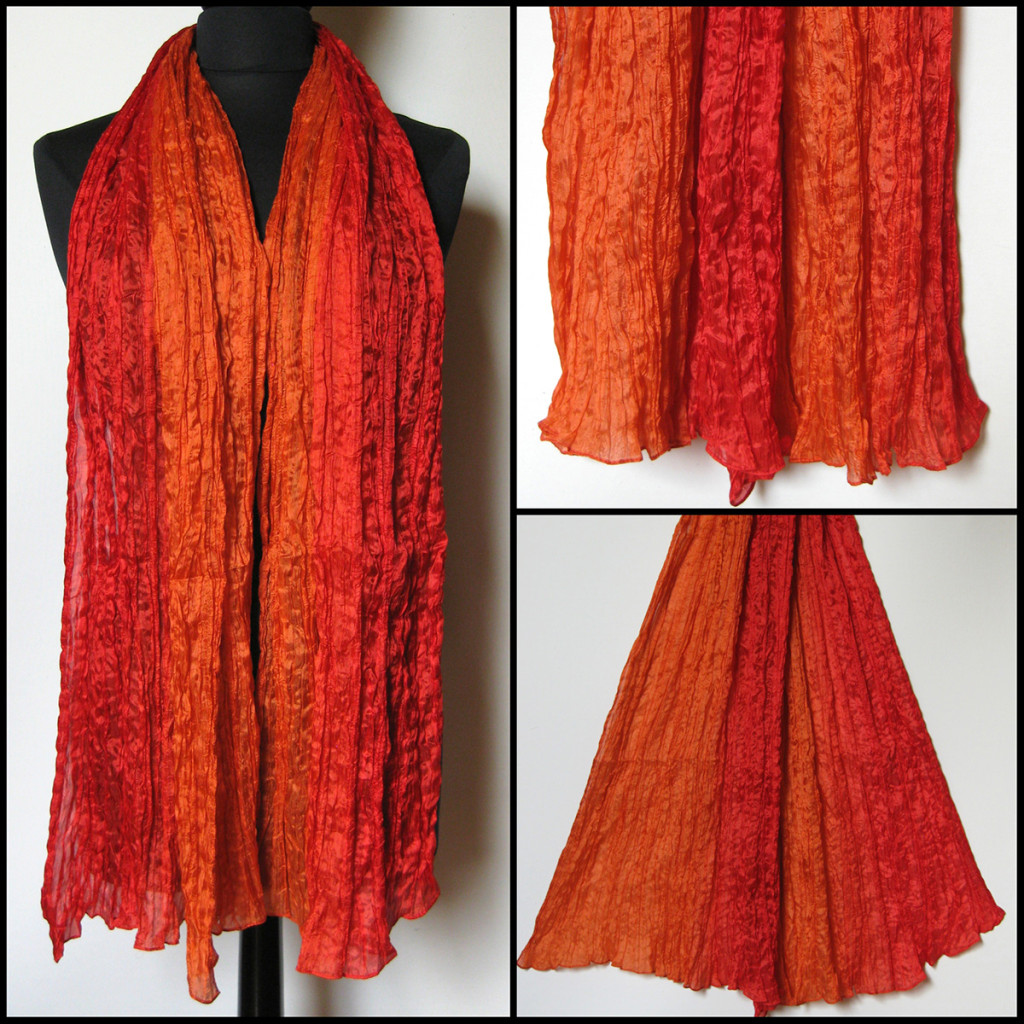 Silketørklæde i røde, orange nuancer. Samarkand har stort udvalg af silketørklæder i mange farver.